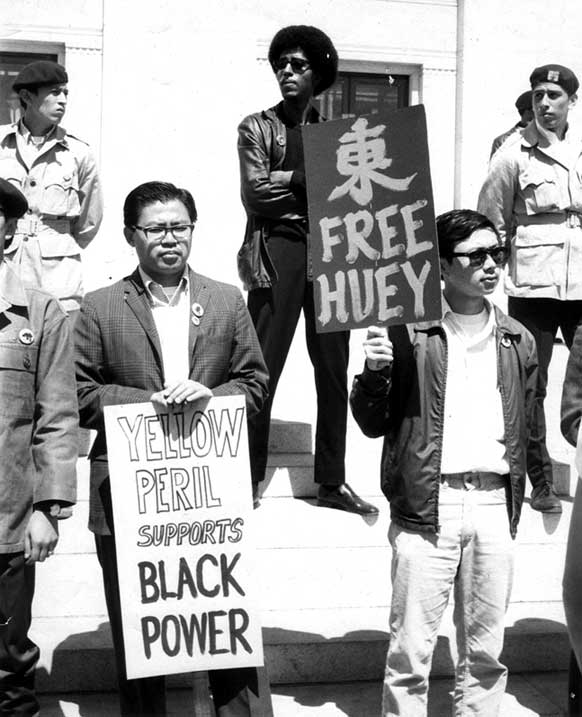 """""""Yellow peril supports Black power""""  Oakland, CA 1968. Photograph by Roz Payne"""